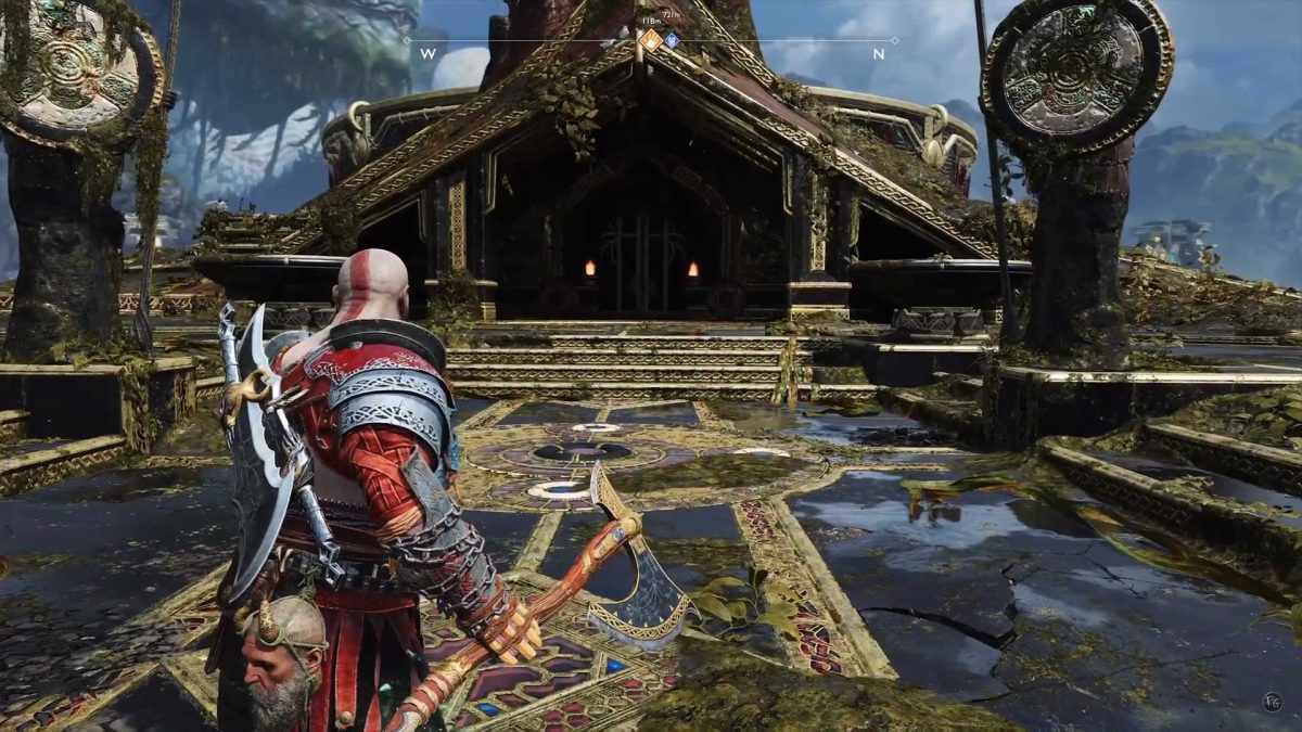 Kratos from behind, with axe in hand, facing a nordic style construction.