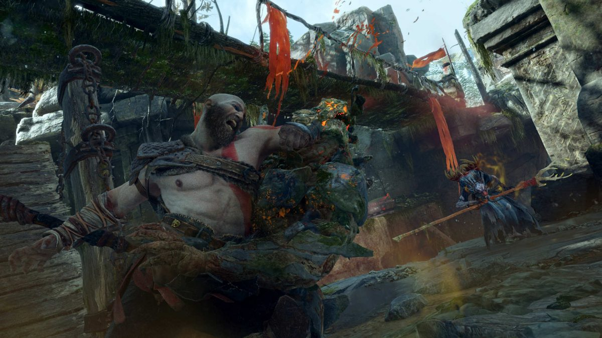 Kratos unarmed dealing a brutal elbow hit to an enemy's face