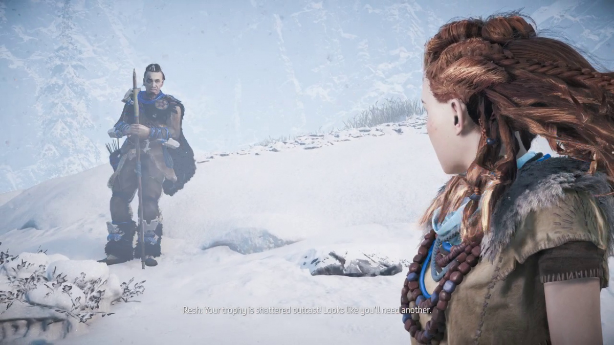 A screenshot from a game cinematic. Aloy is on a snowy mountain, speaking to someone on her left. White subtitles displayed at the bottom, but are illegible because of the white snow behind it.