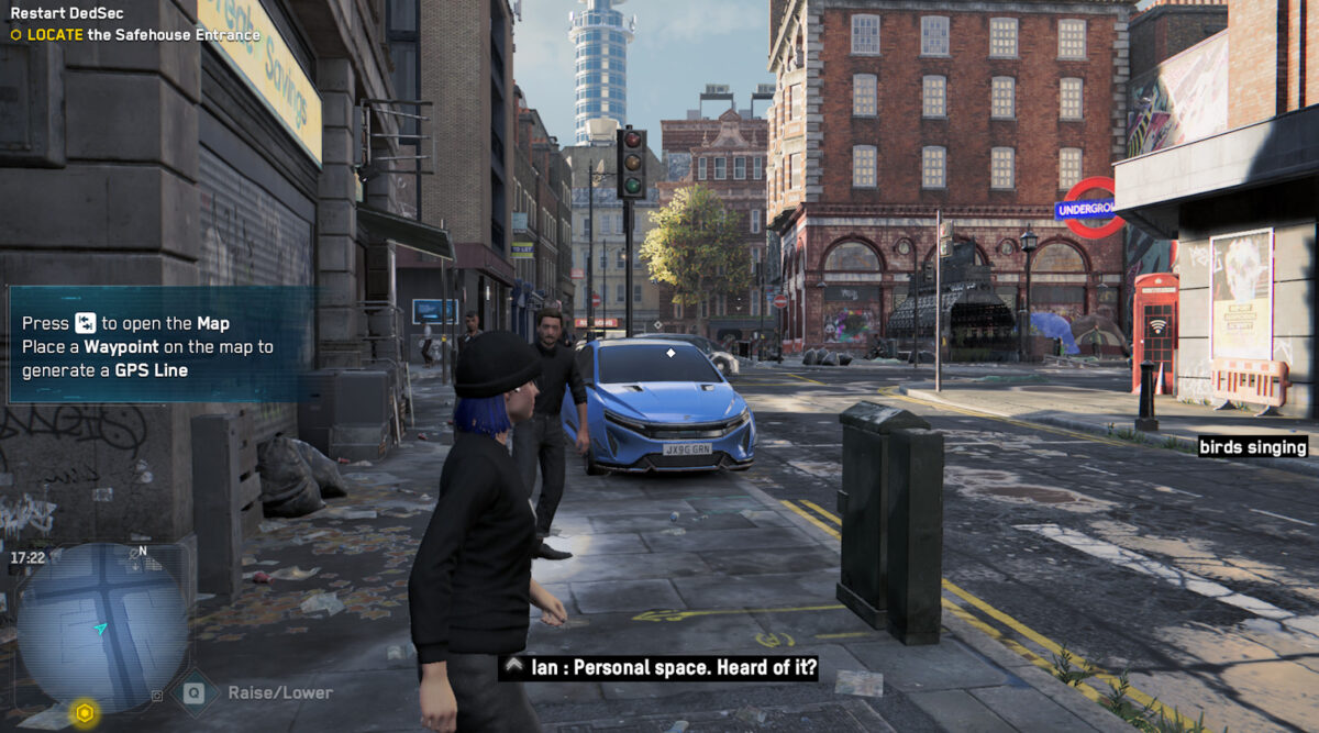 User is standing on the streets of London. Subtitles are bottom center and set to 100%. Subtitle stats Ian: Personal space. Heard of it? the arrow is pointing to a man in front of the user. To the right-hand, cc states birds singing.