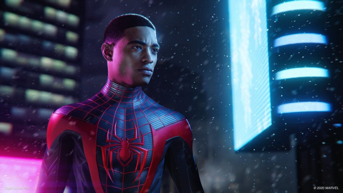 Screenshot from Spider-Man: Miles Morales. Miles is in his spidey suit and looking very serious and ready for some action.
