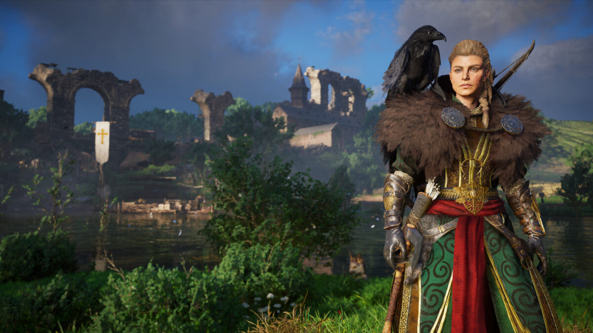 A viking woman standing on the right, wearing green armor and brown furs, with a crow sitting on her shoulder. Green forest and ruins can be seen behind her, with burning smoke in the distance.
