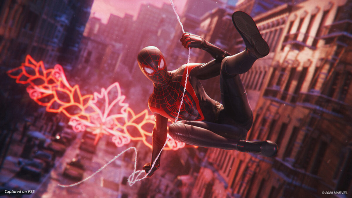 Spider-Man epically swinging from building to building.
