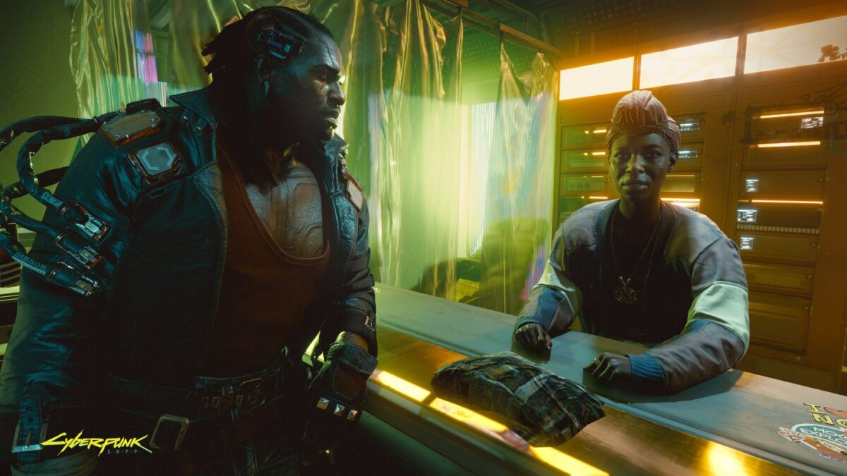 Inside a home. A black man in a slick leather jacket is covered in purposeful scars, indicating cyborg surgery. He has wires coming out of his head and arms, as he turns to look at a black woman with her hair tied. She looks onward to the viewer, seeming to ask a question.