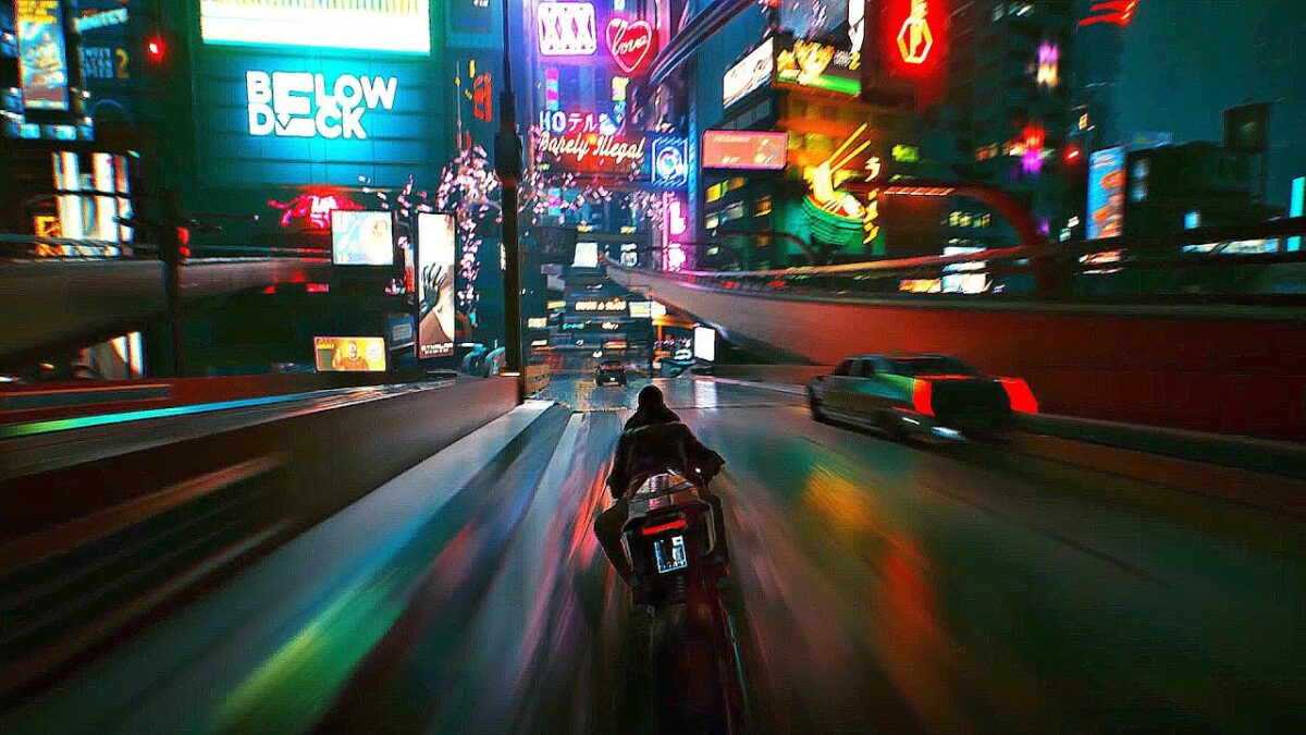 A nighttime view of a street, where a person is driving on a futuristic motorcycle. Flashes of colorful, neon signs pass the driver, as they speed down the lane.