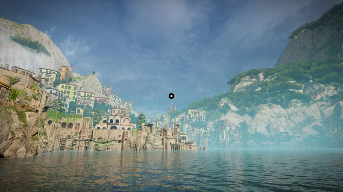 View of the island. The sea is calm. The city looks abandoned on the left side of the coast, and on the right high mountains are partially covered by lush vegetation. In the middle, a big white circle surrounded by a black ring serves as crosshair