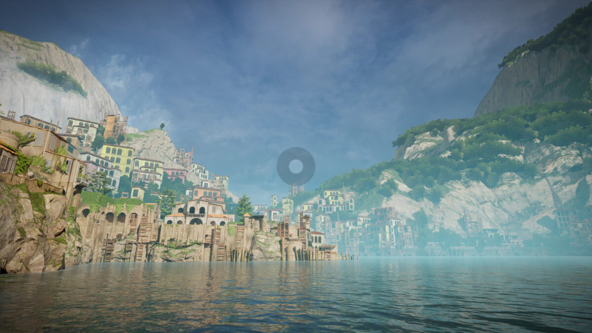 View of the island. The sea is calm. The city looks abandoned on the left side of the coast, and on the right high mountains are partially covered by lush vegetation. In the middle, a giant transparent circle surrounded by a slightly darker ring serves as crosshair