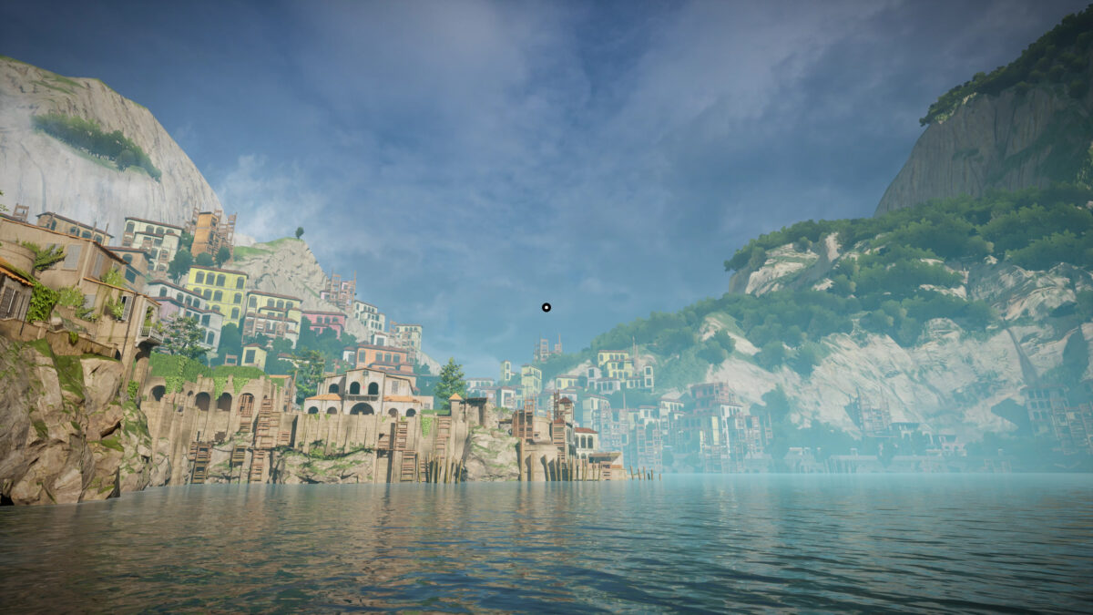 View of the island. The sea is calm. The city looks abandoned on the left side of the coast, and on the right high mountains are partially covered by lush vegetation. In the middle, a medium white circle surrounded by a black ring serves as crosshair
