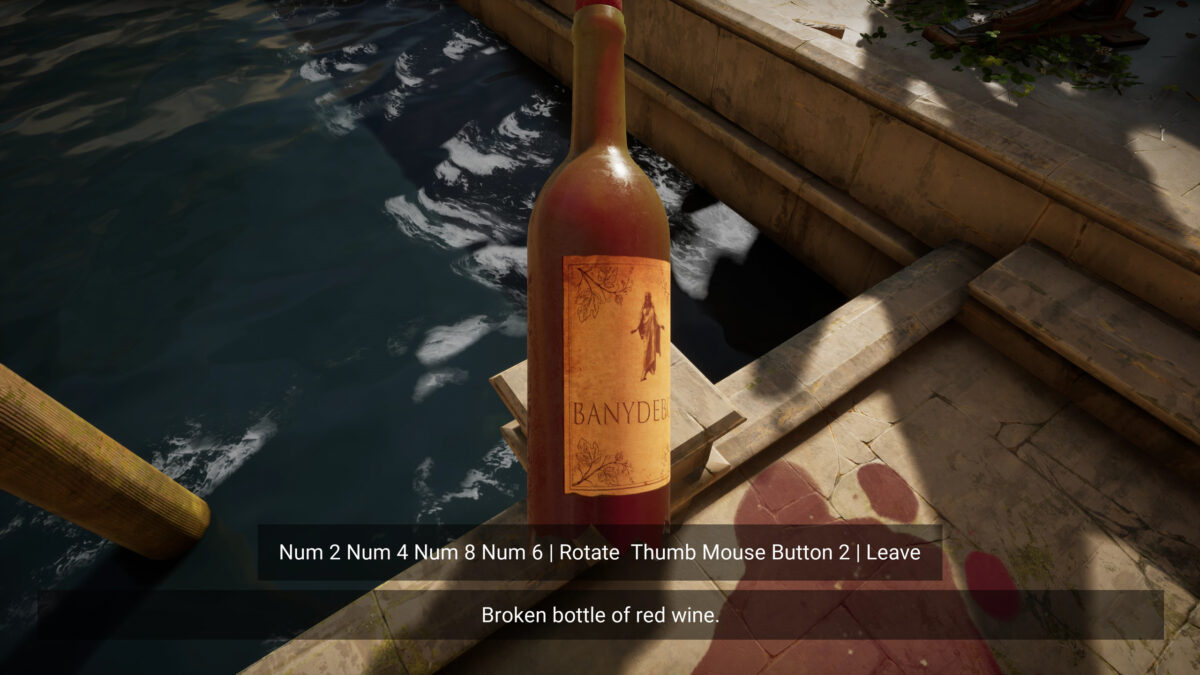 """A broken bottle of wine lays is floating as you examine it. The text to rotate it and leave it appears on the bottomtton 2 Inspect"""" can be read near the bottom of the screen."""