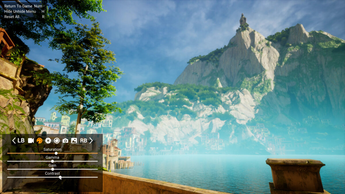 A vista of the sea and a very high rocky mountain on the far side. On the bottom left the Photomode interface shows icons and sliders